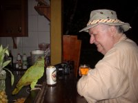 At the bar - parrot flew in and was trying to drink Garth's beer