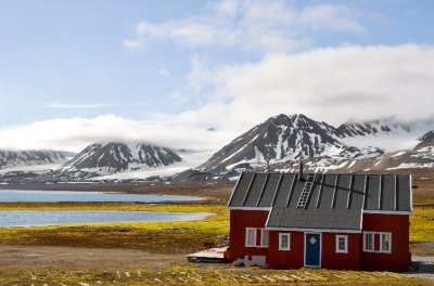 Colourful individual house in the remote village of Ny Alesund in Svalbard that belongs to Norway.