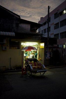 A local bike taxi driver having a haircut