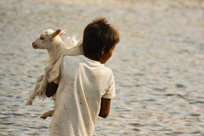 boy_carryi..r_river.jpg