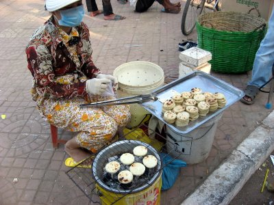 lady selling a kind of coconut filling delicacies