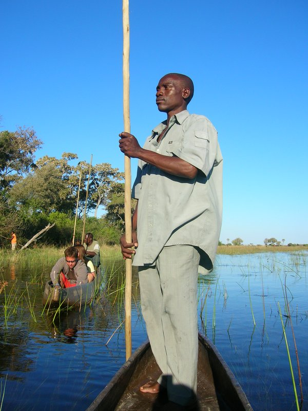 Polers in Okavango Delta