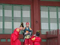 Family prepares for pictures in traditional dress, Seoul, South Korea