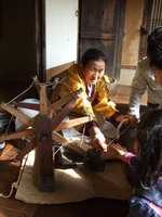 Woman demonstrates traditional cloth making in South Korea