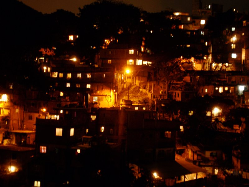 Favela viewed from an Ipanema window at night