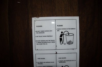 Odd sign at toilets in Qurikancha, Cusco