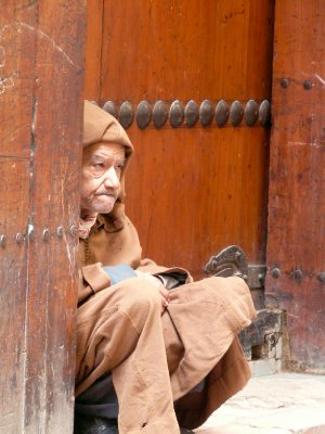 Man sitting outside the Kairaouine Mosque