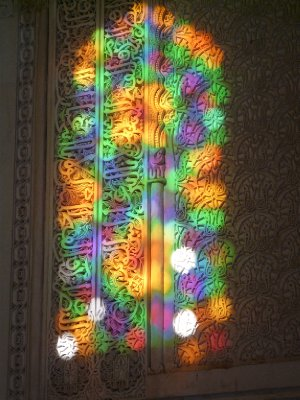 Sunlight through tainted glass in the Bou Inania Medersa