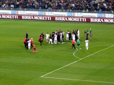 Milan players celebrating after securing the Scudetto away against Roma