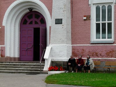 Locals outside the House of Prayer of Daugavpils First Old Believers Community