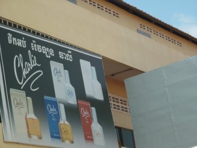 Lo's favorite perfume on the wall at Poipet bus termina-