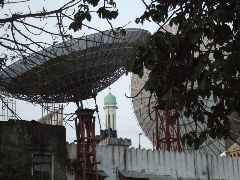 Minaret between Satelite dishes