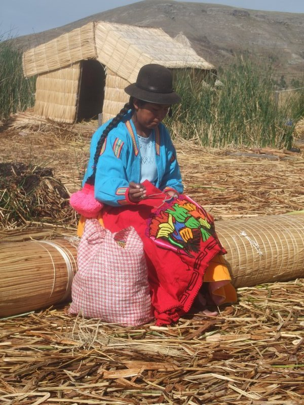 Woman living in the reed island community of Uros, Lake Titikaka