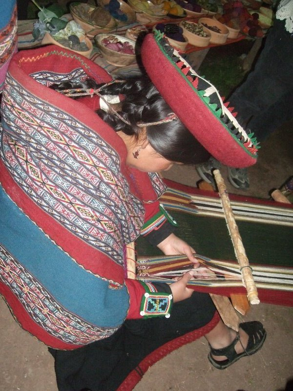 Woman weaving at Chinchero