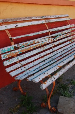 Bench and a red wall