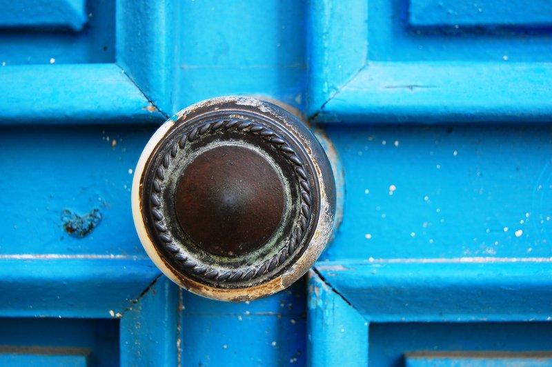 An ornate blue door