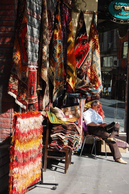 Man selling carpets