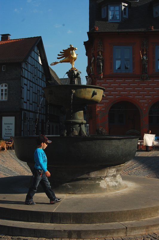 A child by a fountain 2