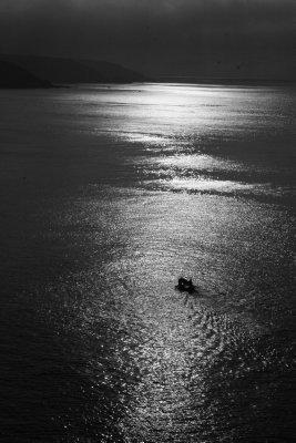Fishing Boat laying pots at dawn