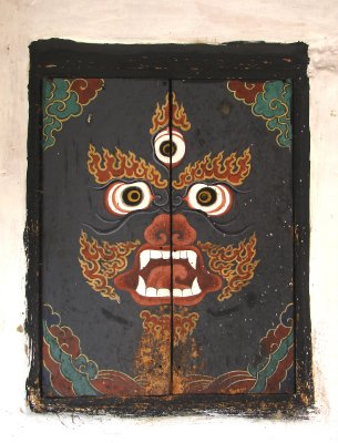 MahaKala (protector deity) on shutters at Jampel Lhakhang