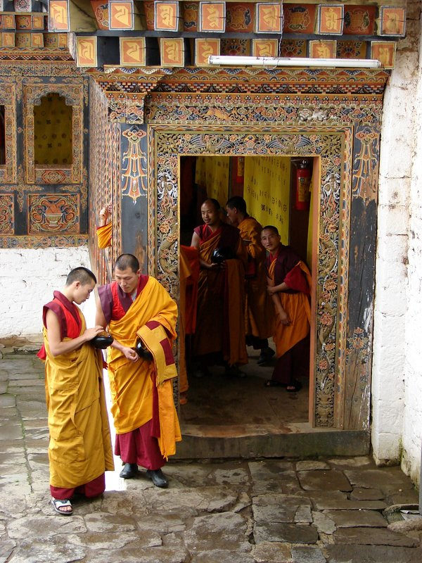 Monks entering temple for afternoon prayers, Tango Goemba.