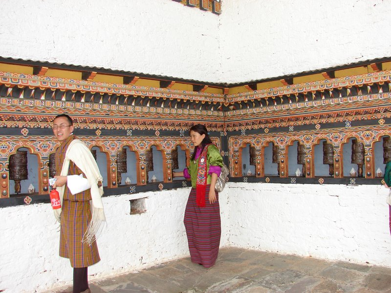 Turning Prayer wheels at Punakha Dzong outside temple