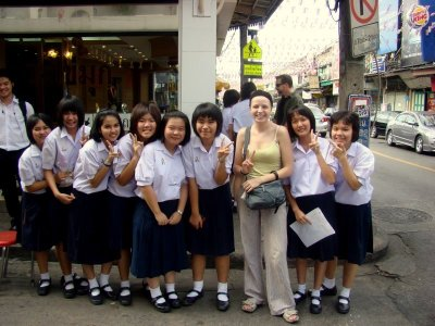 julia with group of thai tourism students helping them with their project