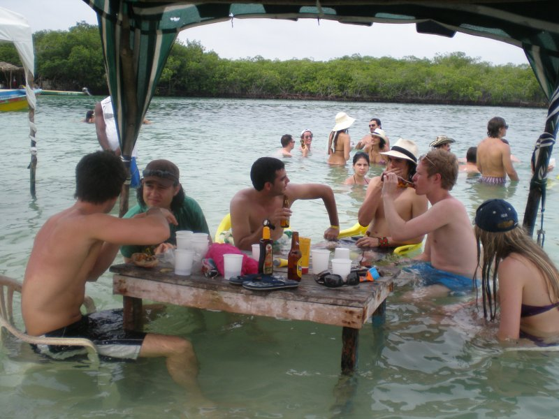 Sitting around tables in the water
