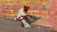 guru reading newspaper in Benares Varanasi