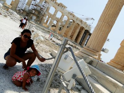 Mom watching over curious Ylla in Acropolis