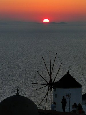 Sunset and mill in Oia