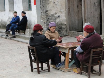 Chinese old people playing cards in Xingping