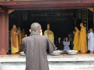 Monk taking a pic in Linh-Mu Pagoda, Hue