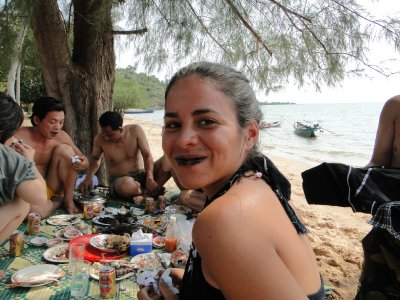 Me eating squid with a group of locals, Rabbit Island
