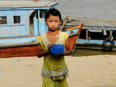 Girl carrying water bowl, Mandalay