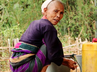 Old Palaung Lady doing laundry, Shan State