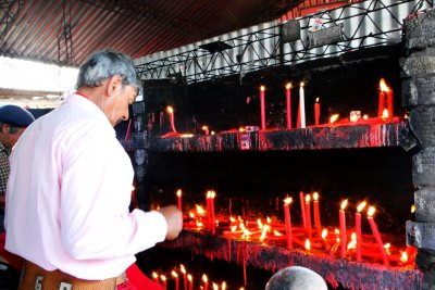 Lighting candles to the &#34;Saint&#34;