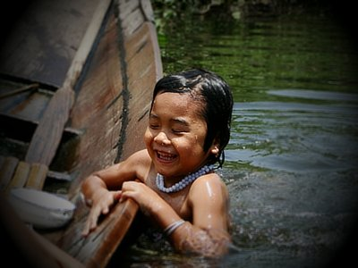 Girl going for a swim in a floating village, Inle Lake