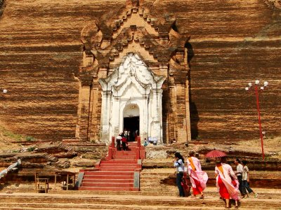 Female Buddhist nuns at the entrance gate of Mingun Paya