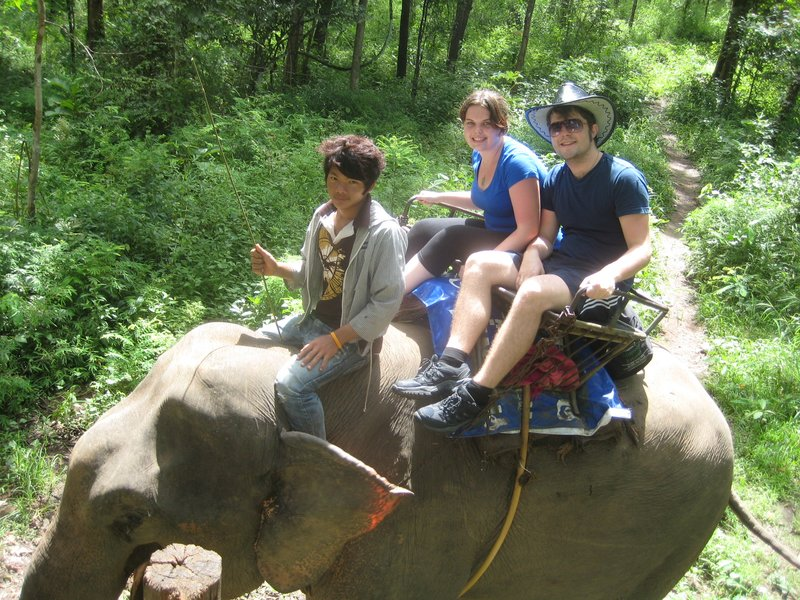 Kate and Sam riding an elephant