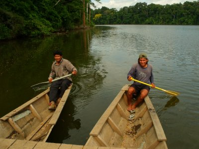 Our oxbow lake rowers. Manu National Park, The Amazon Rainforest.