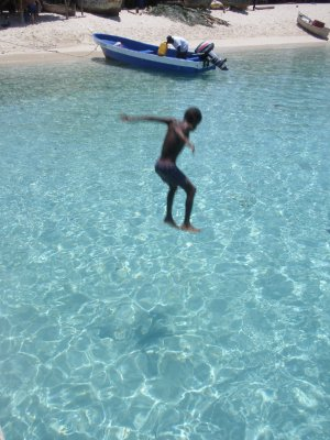 Boy jumping into the Caribbean, Honduras Bay Islands