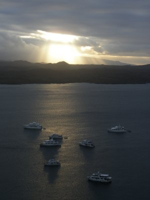 Sunset in the Galapagos Islands. Our boat is closest.