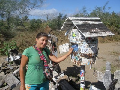 Marsha posting our cards at Post Office Bay in the Galapagos Islands