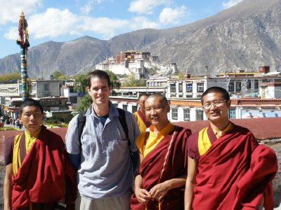 Patrick and monks in front of the Potala Palace