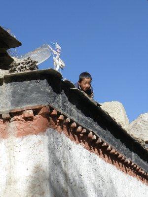 Tibetan boy on the roof