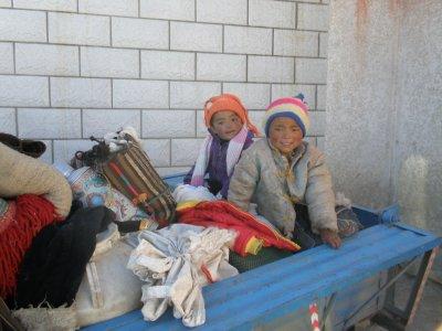 Tibetan children playing in a skip