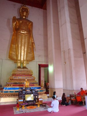 standing Buddha and monk