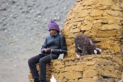 Tibetan girl charging for photos with her goat