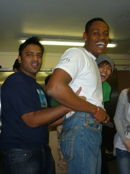 Akash attempting to pull Nathan's pants UP